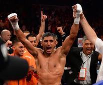 Amir Khan back to Golden Boy for Alvarez fight on May 7 in Vegas