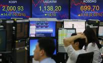 Seoul shares end lower after BOJ's surprise move