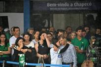 Brazil mourns fallen football team in pouring rain