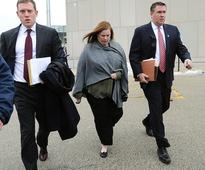 Widow of disgraced Illinois policeman pleads not guilty to fraud charges