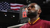 LeBron says he'll stand during anthem
