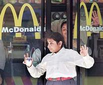 Ownership battle in McDonald's takes toll on business