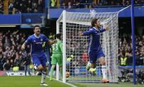 Hazard scores mesmerizing solo goal as Chelsea beat Arsenal