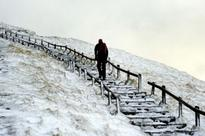 Britain sees FIRST SNOW of winter as forecasters warn of plummeting temperatures