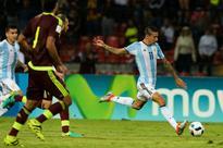 Messi-less Argentina deny Venezuela