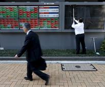 Nikkei edges up, Fast Retailing shines on solid sales