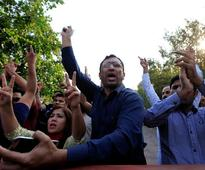 Pakistan police fire tear gas at stone-throwing opposition leader supporters