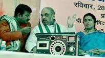Amit Shah listens to PM's 'Mann ki Baat' with slum-dwellers in New Delhi