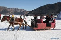 Winter fishing tourism festival celebrated in N China's Inner Mongolia