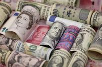 Dollar edges up versus yen, higher yields support euro and sterling
