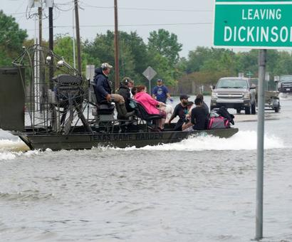 Texas gets its boats out as streets turn into raging rivers