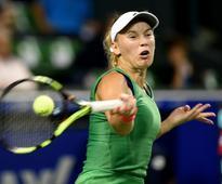 Wozniacki battles into Tokyo final