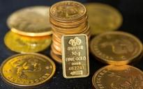 Gold down on dollar strength, political risks lend support