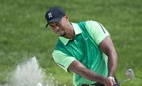 Tiger says he'll be back