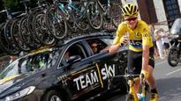 Tour de France: Chris Froome cements Tour great status with third title