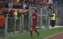 Roma pounce on errors to win hot-tempered derby