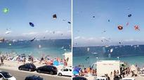 'An inflatable flamingo flew past me': Colourful mayhem as whirlwind hits beach in southern France