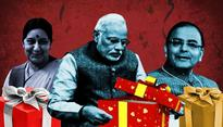 Secret Santa picks out (totally fake) X-mas gifts for Indian politicians