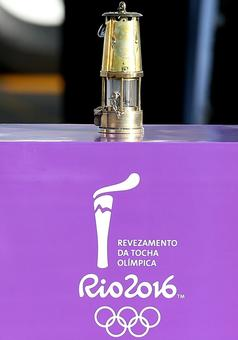 PHOTOS: Olympic flame lands in Brazil for three month relay to Games