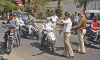 Helmet drive: Police action slows down