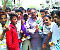 Congress workers celebrate the victory of Vivek Tankha for Rajya Sabha at Prithvipur