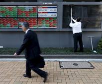 Yen posts biggest weekly gain since 2008, stocks slip