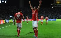 Benfica scores late against Porto to grab point in Portugal