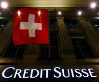 Credit Suisse faces tough questions after $1 bln write-downs