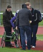 Prince Harry on hand to help athlete after wheelchair blows over in the wind