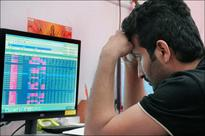 Sensex, Nifty dragged lower by global cues, healthcare stocks