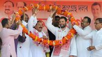 Assam polls: Modi takes jibe at Gogoi, Rahul targets PM on black money