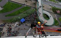 Wheelchair-bound man rappels down Prague building