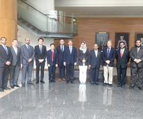 SQU delegation visits Singapore