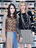 Courtney Love and Frances Bean Cobain both wear sunglasses at night as they arrive back in LA after PFW