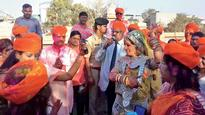 Tourists celebrate Holi with Justice GK Vyas