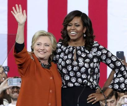 Michelle Obama campaigns with her 'girl' Hillary Clinton