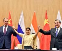 Russia throws weight behind China's Belt and Road, urges India to join