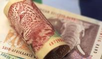 South Africa's rand slips on downgrade fears; Bidvest lifts stocks