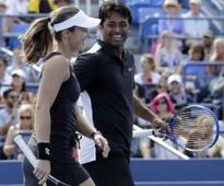Paes-Hingis enter French Open quarter-finals