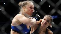 Amanda Nunes stops Ronda Rousey in 48 seconds at UFC 207