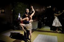 Obama slammed for doing the tango in Argentina, cosying up with dictator in Cuba as terror fears grip Europe