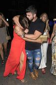Braless Vicky Pattison accidentally flashes nipple pasties as she holds hands with Rogan O'Connor on night out