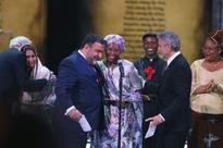 George Clooney presents $1.1-M award to Catholic woman who built orphanage that saved thousands of children's lives