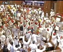 Opposition creates ruckus in UP Assembly, flings paper balls at Governor