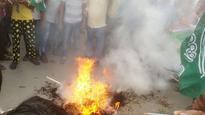 BJD burnt the effigies of Uma Bharti, Chhattisgarh CM over mahanadi issue