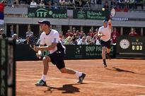Visitors Britain, Argentina, France lead in Davis Cup QFs