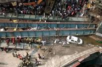 India overpass collapse kills 14; scores feared trapped