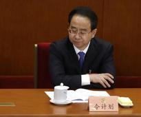 China formally charges former aide to retired president