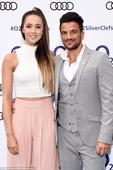 Pregnant Emily MacDonagh reveals a hint of her tum with Peter Andre at the Silver Clef Awards