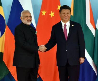 PM, Xi display bonhomie at BRICS Summit